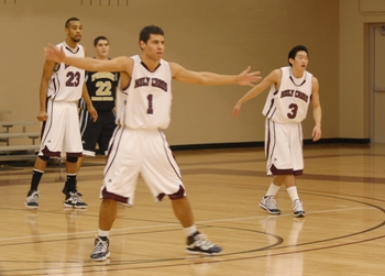 Taylor Williams, Adam Dobbs, and Dane Okuda Protect Their Basket During a Conference Game Last Season