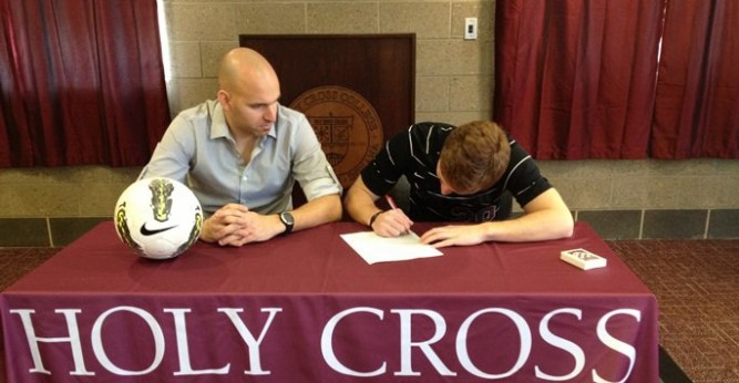 Austin Haire signing his LOI with Saints head coach Omar Gallo