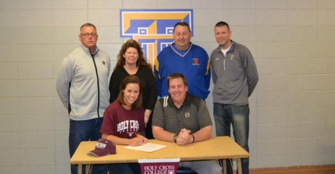 Emily Duff joined by coach Holt and friends while signing her letter of intent to Holy Cross