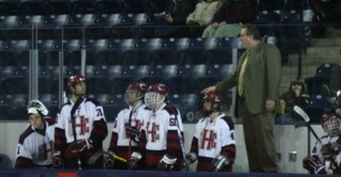 T.J. Lyons was named the third coach in Saints hockey history