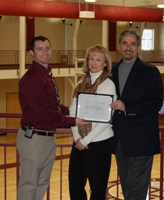 Athletic Director Nathan Walker (left) with Angela and Kevin Leo