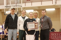 Katie Fetters with family and athletic director Nathan Walker