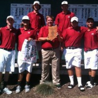 The Saints posing with their 1st place trophy from the IWU Fall Invitational.