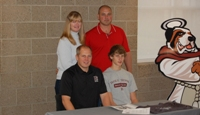 T.J. with Coach Harley and Family